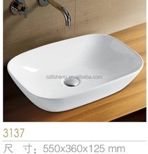 Pure white smooth countertop art small bathroom sink oval shaped wash ceramic hand wash basin