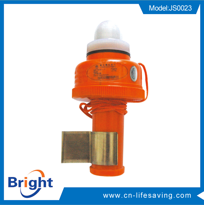 Self-lighting life buoy light with cradle