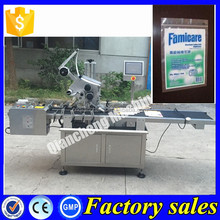 Alibaba China plastic bag labeling machine,sticker labeling machine