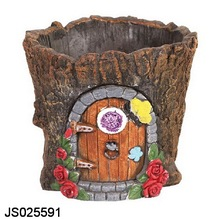 Resin trunk planter with faiy door design, for decorating the garden