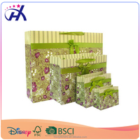 Yiwu manufacturer supply OEM based cheap paper gift bag with ribbon bow tie