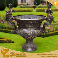 bronze flower pot with angel statue