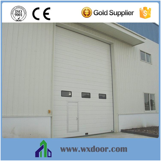 Power operated vertical overhead lift industrial sectional exterior doors