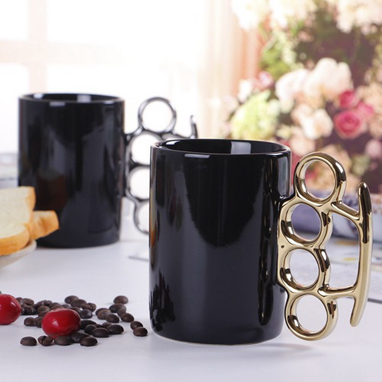creative <strong>black</strong> and white giled fist knuckle gift ceramic mug with plated gold silver handle