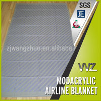 Modacrylic flame retardant airline blanket with logo jacquard design
