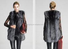 Combine color of red knitted red fox fur vest with a big fur ball lovely