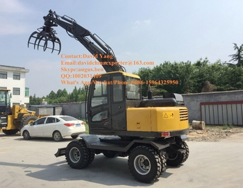 wheel excavtor with swing wood grapple for sale