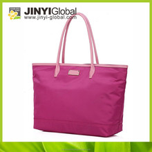 You'll never get tired of the compliments you receive out on the beach with this casually pretty shopping bag/Textured nylon to