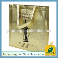 Flash gold/silver film non woven bag with ribbon webbing handle shopping bag in guangzhou factory