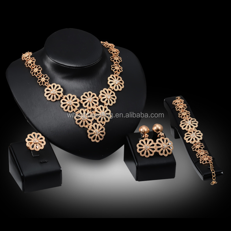 Women's gold jewelry four <strong>sets</strong> of large hollow flowers, earrings, necklaces, bracelets, rings, high quality artificial crystal d
