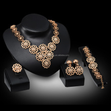 Women's gold jewelry four sets of large hollow flowers, earrings, necklaces, bracelets, rings, high quality artificial crystal d