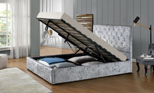 Fabric bed frame with gas lift storage