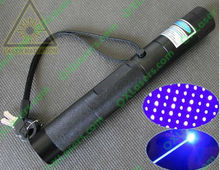OXLasers OX-B301S adjustable 2000mw blue laser pointer with star cap and keylock burn paper