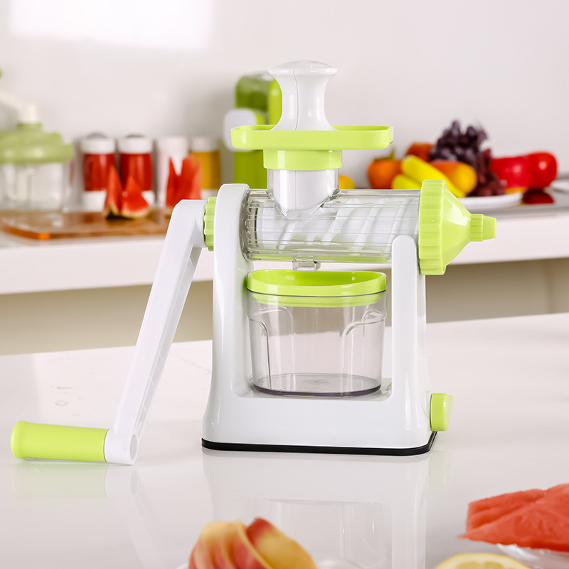 pink plastic fruit and vegetable squeezer juicer
