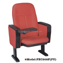 Floor mounted auditorium chair with writing tablet