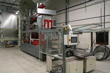 Fully automated single large packaging baler with a form, fill and seal device.