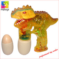 Dinosaur battery operated toy bubble blowing gun w/2 bottles of bubble liquid