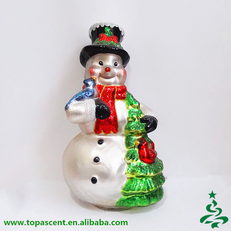 Hot Sell Bulk Handicraft Glass snowman holiding x'mas tree and cardinal table piece for Christmas indoor decoration
