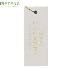 China luxury custom debossed gold/silver stamping recycled kraft paper hang tags wholesale
