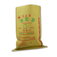Kraft paper and plastic material compound bag packing construction