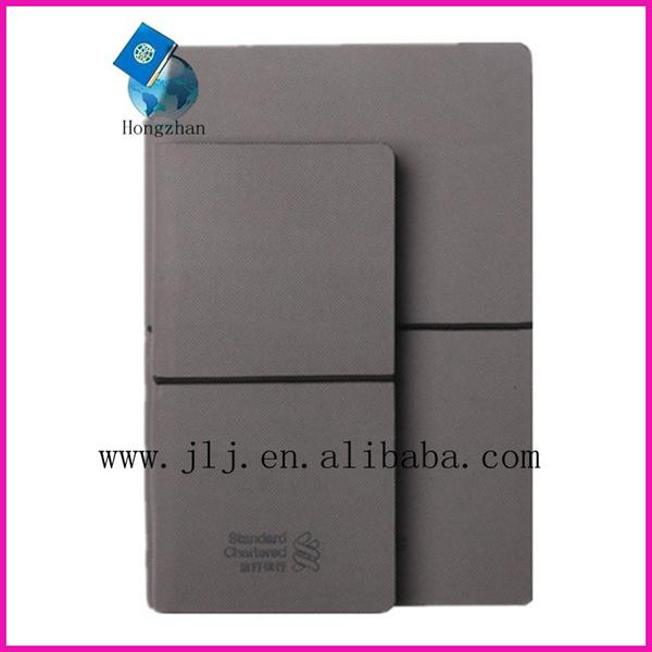 Pocket notebook with pen holder