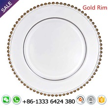 Wholesale clear glass beaded charger plate with gold rim lace reef for wedding table decoration