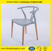 Modern grey plastic Y back chair designed by hans wegner