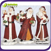 2014 resin santa hugging kid ornament
