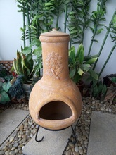 Outdoor fireplace BBQ sunflower clay chimenea
