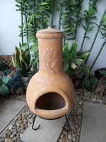 Outdoor sunflower clay chimenea BBQ