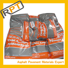Cold mix asphalt repair material