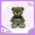 Plush sitting brown bear ,stuff with dressing