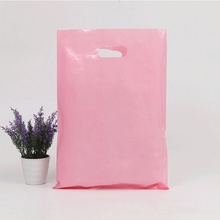Large and medium sized plastic gift packaging bags of boys and girls clothing carry bags wholesale custom logo