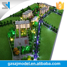 Low rise residential model with miniature trees, Home building model