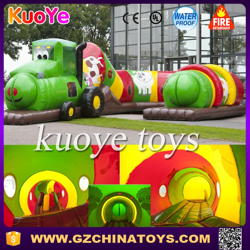 green inflatable tunnel tractor obstacle course for kids