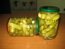 Pickled baby cucumbers in glass jar