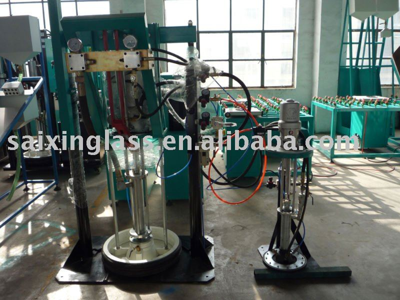SEALANT SPREADING MACHINE