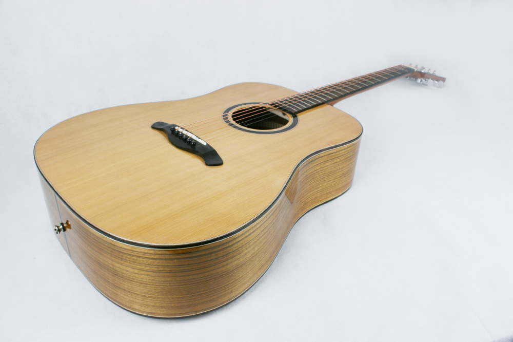 Handcrafted solid top acoustic guitar