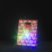 Customized your style lighting up presenting musical Christmas paper bag for gift
