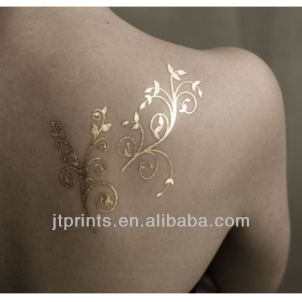 Unique gold tattoo on shoulder for women