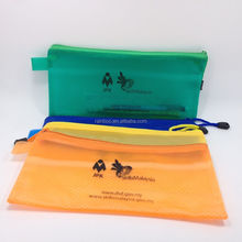 Logo printed cheap clear pvc pencil pouch with zipper and tag