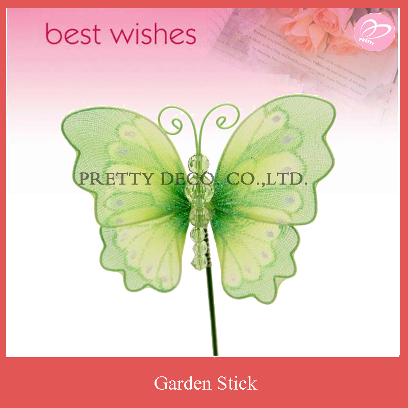 Green butterfly with spring in back and movable wooden stick garden decoration