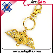 Gold plated enamel snow globe keychain