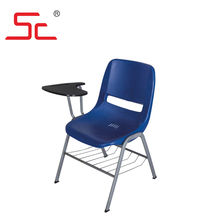 Plastic school chair with writing pad for student