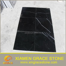black nero marquina marble tiles with white veins