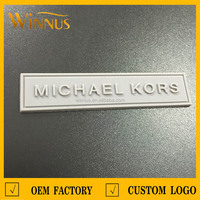 custom brand name logo 3d soft pvc labels for clothing