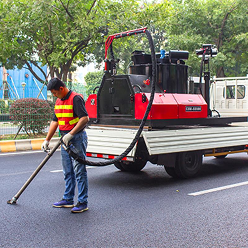 asphalt pavement crack sealing melter applicator