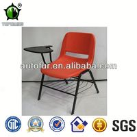 Plastic school chairs with writing pads