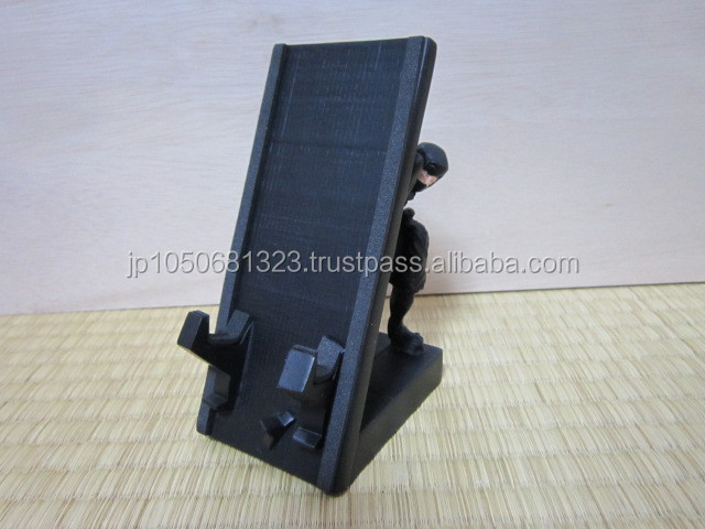 Realistic and fashionable Ninja cell phone stand made from polyresin