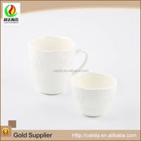 Modern embossed fruit design white fine porcelain cup with saucer